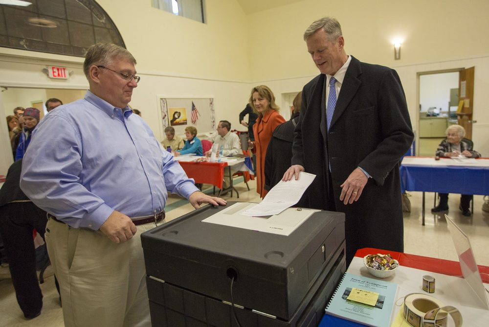 Gov. Charlie Baker casts his ballot on Election Day in Swampscott. He was the 40th person to cast his ballot there. (Jesse Costa/WBUR)