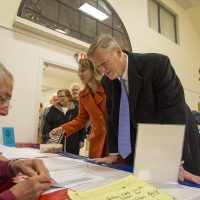 Gov. Charlie Baker checks in to receive his ballot this past Election Day. (Jesse Costa/WBUR)