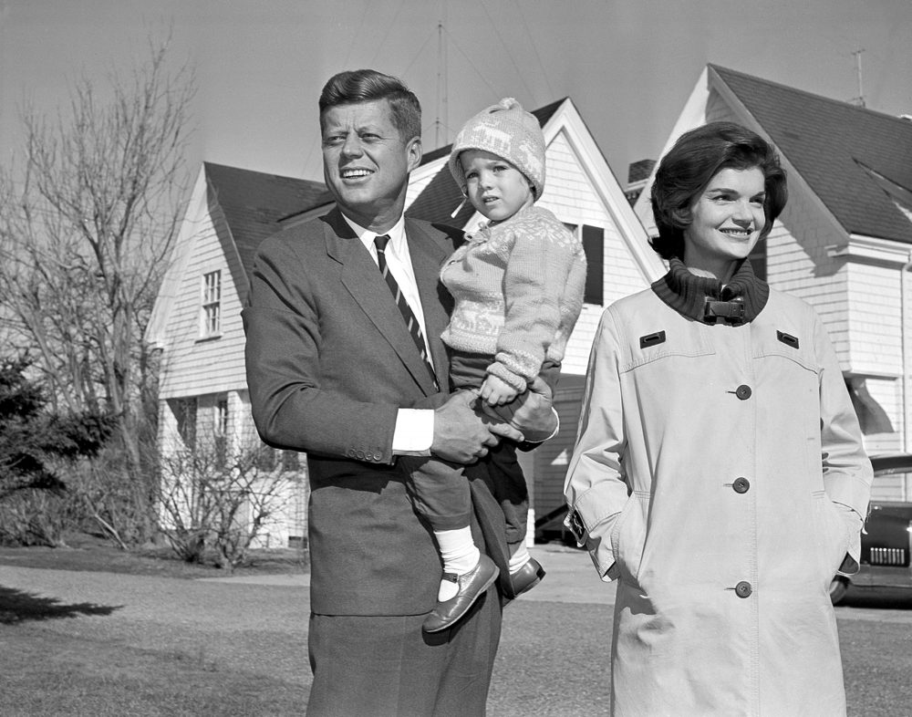 Democratic presidential nominee Sen. John F. Kennedy, with his wife Jacqueline and daughter Caroline, outside their home in Hyannis Port, Mass. on Nov. 8, 1960. (AP)