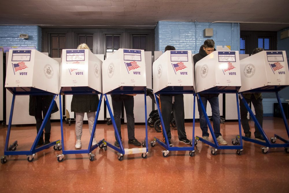 Voters fill out their forms at a polling station in the Brooklyn borough of New York, Tuesday, Nov. 8, 2016. (Alexander F. Yuan/AP)