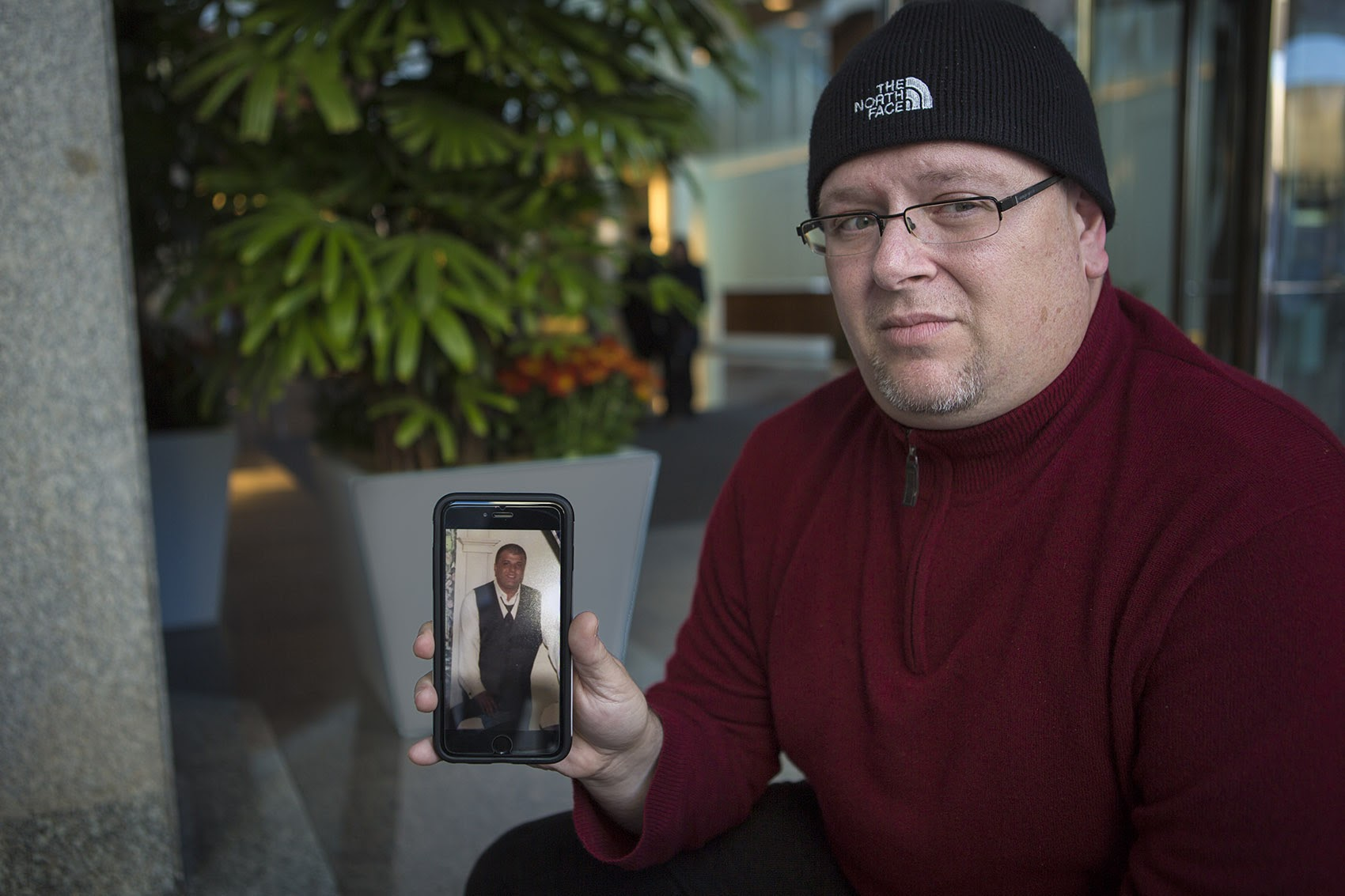 Anthony Salemi showing a photo of his brother Joe who overdosed on fentanyl earlier this year. (Jesse Costa/WBUR)