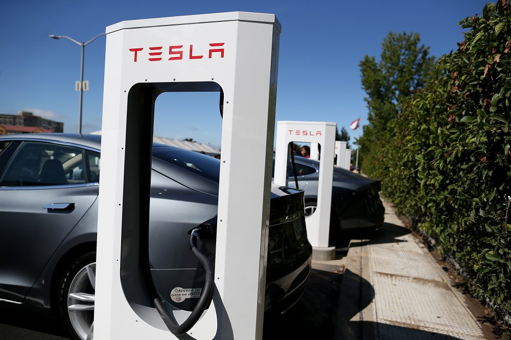 A Tesla Model S sedan is seen plugged into a new Tesla Supercharger outside of the Tesla Factory on Aug. 16, 2013 in Fremont, Calif. (Justin Sullivan/Getty Images)