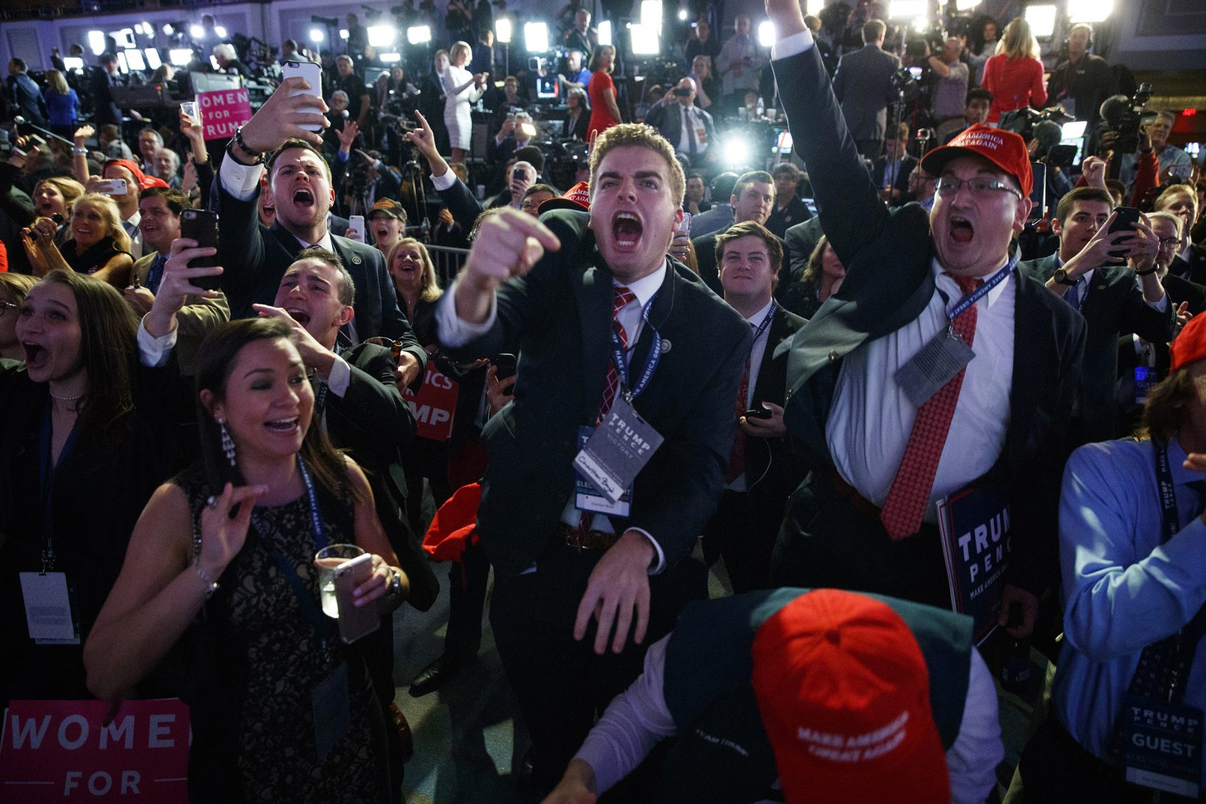 Donald Trump supporters cheer as they watch election returns Tuesday night in New York. Trump won the presidency in an upset, after a tumultuous campaign. (Evan Vucci/AP)