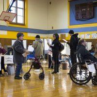 Voters wait in line to vote at East Boston High School. (Robin Lubbock/WBUR)