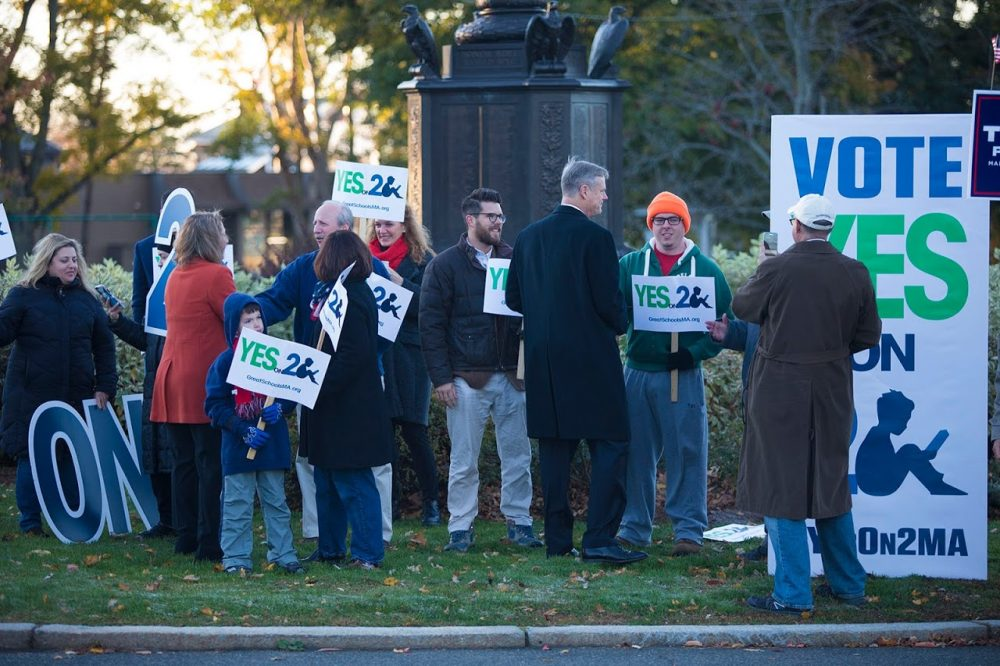 Gov. Baker greets supporters of lifting the cap on charter schools on Monument Avenue in Swampscott. (Jesse Costa/WBUR)