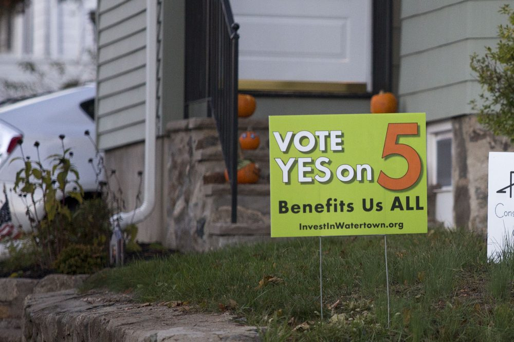 A sign in favor of adopting the Community Preservation Act is seen on Carroll Street in Watertown, one of the 11 communities to pass the measure. (Jesse Costa/WBUR)