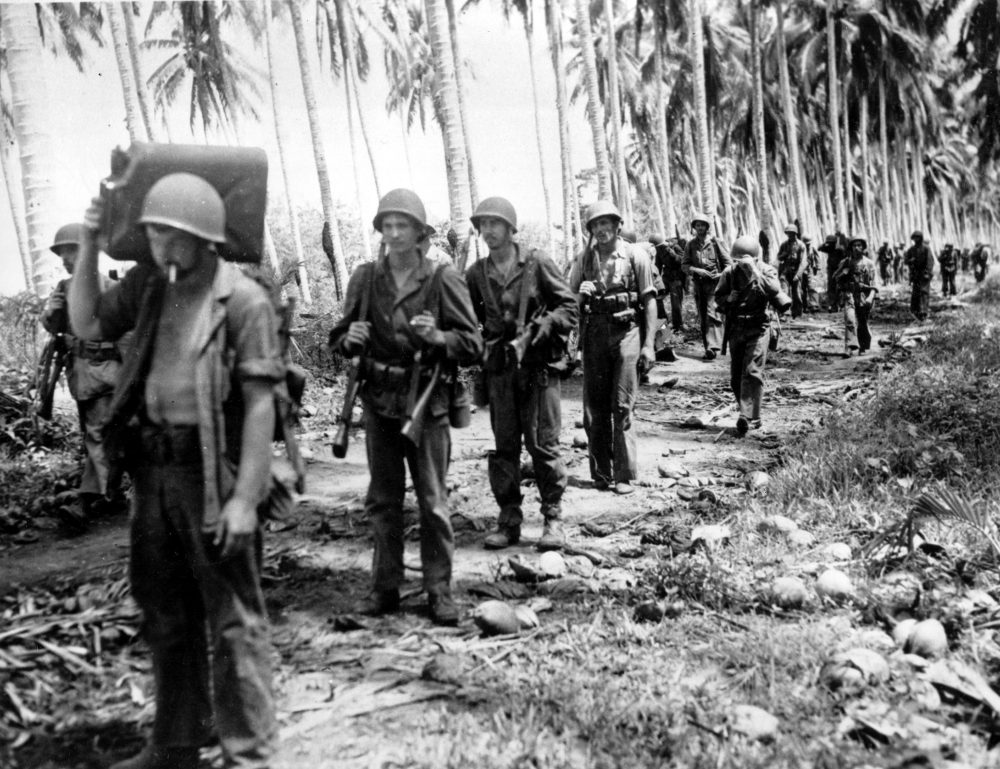A contingent of U.S. Marines advances along a Guadalcanal jungle road toward Tassafaronga in the Solomon Islands in February 1943 during World War II. (AP)