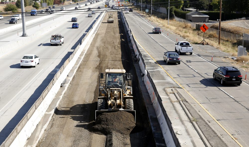 Vehicles pass a highway construction site on Interstate 80 in Sacramento, Calif., in October 2015. (Rich Pedroncelli/AP)