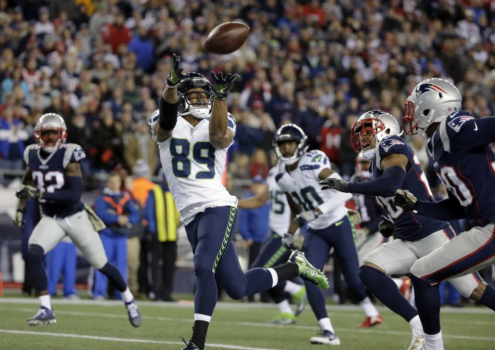 Seahawks wide receiver Doug Baldwin (89) catches a pass for his third touchdown of the game during the second half of Sunday's game against the Patriots. (Steven Senne/AP)