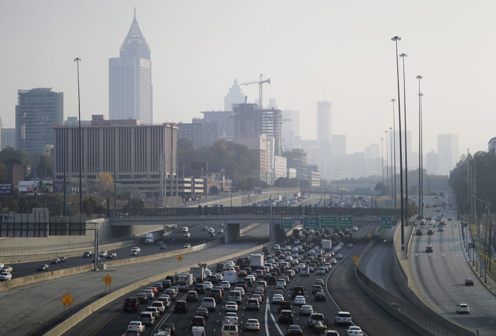 A haze hovers over the downtown skyline from a wildfire burning in the northwest part of the state, Monday, Nov. 14, 2016, in Atlanta. (David Goldman/AP)