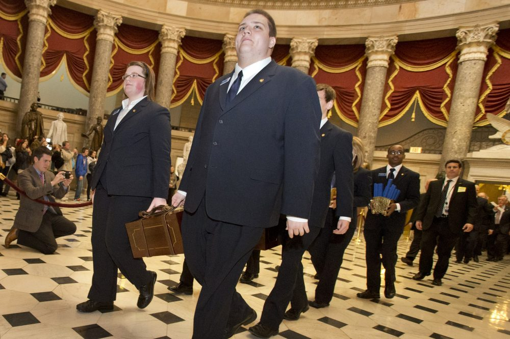 Pages lead a Senate procession carrying two boxes holding Electoral College votes through Statuary Hall to the House Chamber on Capitol Hill in Washington, Friday, Jan. 4, 2013, for the counting of the votes in the presidential election. (Jacquelyn Martin/AP)