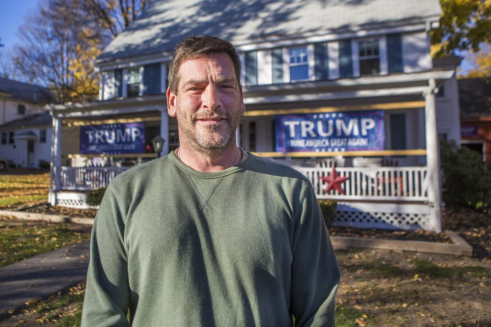 Robert Woolworth stands in front of his house on Main Street in Saugus, which is decked out with Trump campaign signs. (Jesse Costa/WBUR)