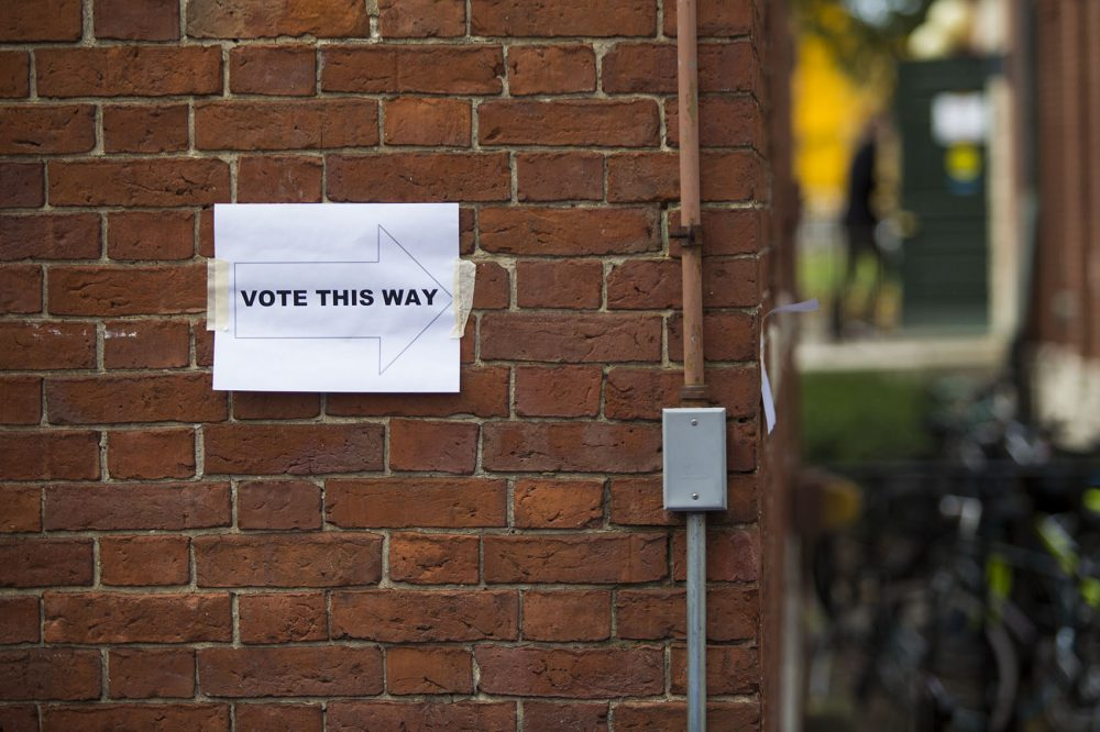 A sign shows Harvard students the direction to Phillips Brooks House, one of three polling places on campus Thursday to vote for the student union election. (Jesse Costa/WBUR)