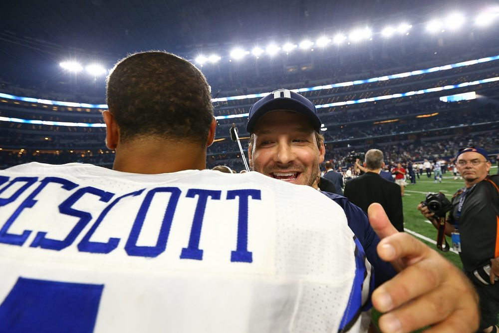 Dak Prescott of the Dallas Cowboys hugs Tony Romo after a win against the Chicago Bears at AT&T Stadium on Sept. 25, 2016 in Arlington, Texas. (Ronald Martinez/Getty Images)