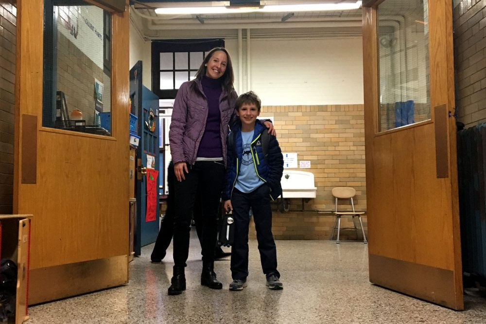 Toby Damon, 8, with his mother, Barb Damon, at the Phineas Bates Elementary School in Roslindale. (Tonya Mosley/WBUR)