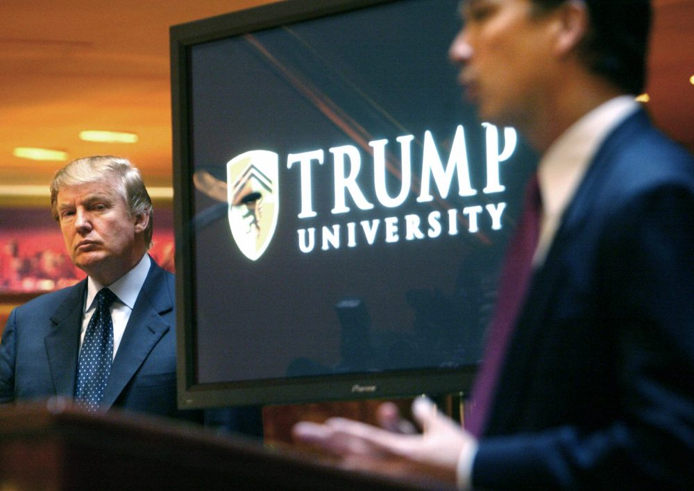 In this May 23, 2005 file photo, Donald Trump listens as Michael Sexton introduces him at a news conference in New York where he announced the establishment of Trump University. (Bebeto Matthews/AP)