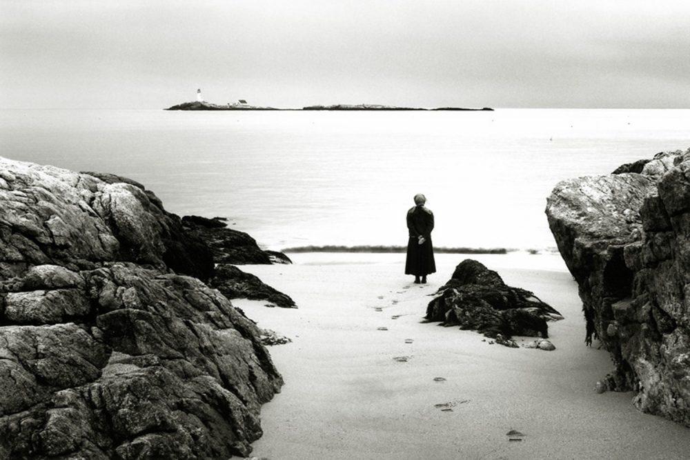 Alexandra de Steiguer looks out from Star Island toward the White Island Lighthouse. (Courtesy of de Steiguer)