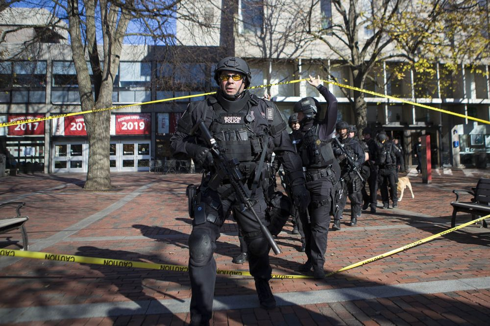 A Boston Police Department tactical unit responded to Boston University's Mugar Library Friday morning after police received a call from a man claiming to be inside the building with guns and explosives. Police found nothing and determined the call was a hoax. (Jesse Costa/WBUR)
