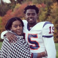 Khaneil Bruce with his mother. Bruce, who's blind in his left eye, plays wide receiver for the University of New Haven. (Courtesy of Khaneil Bruce)
