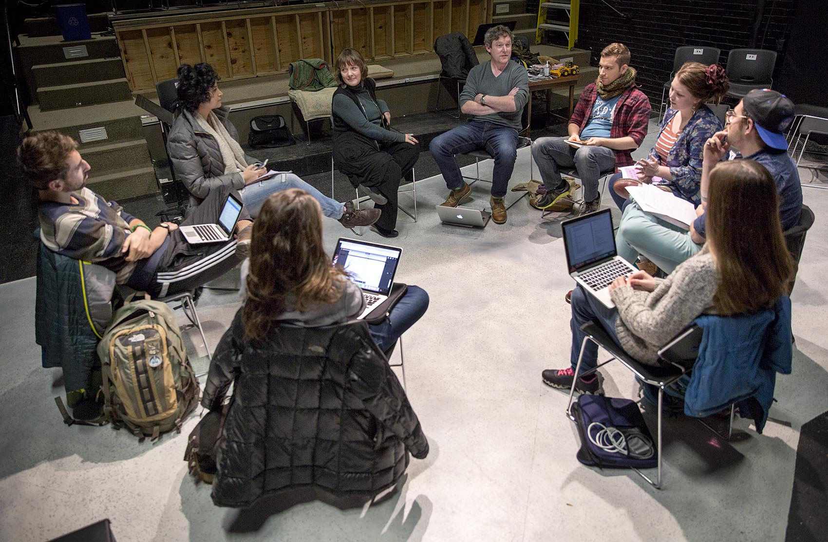 A class of theater and playwrighting students assemble inside the Boston Playwrights' Theatre. (Robin Lubbock/WBUR)