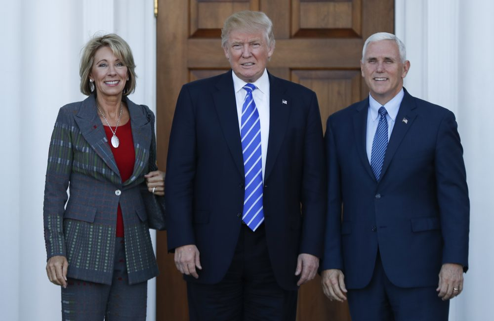 President-elect Donald Trump and Vice President-elect Mike Pence and Betsy DeVos pose for photographs at Trump National Golf Club Bedminster clubhouse in Bedminster, N.J., Saturday, Nov. 19, 2016. (Carolyn Kaster/AP)