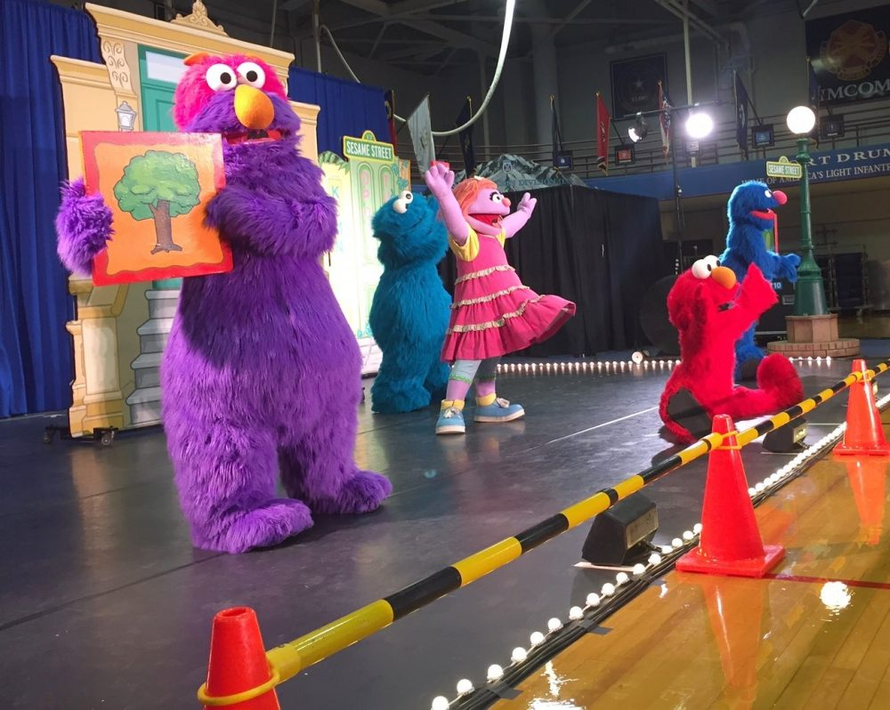 Sesame Street is taking live shows like this one, featuring the muppet Katie, a military kid who is sad about an upcoming move, to military bases around the country. (Julia Botero/NCPR)