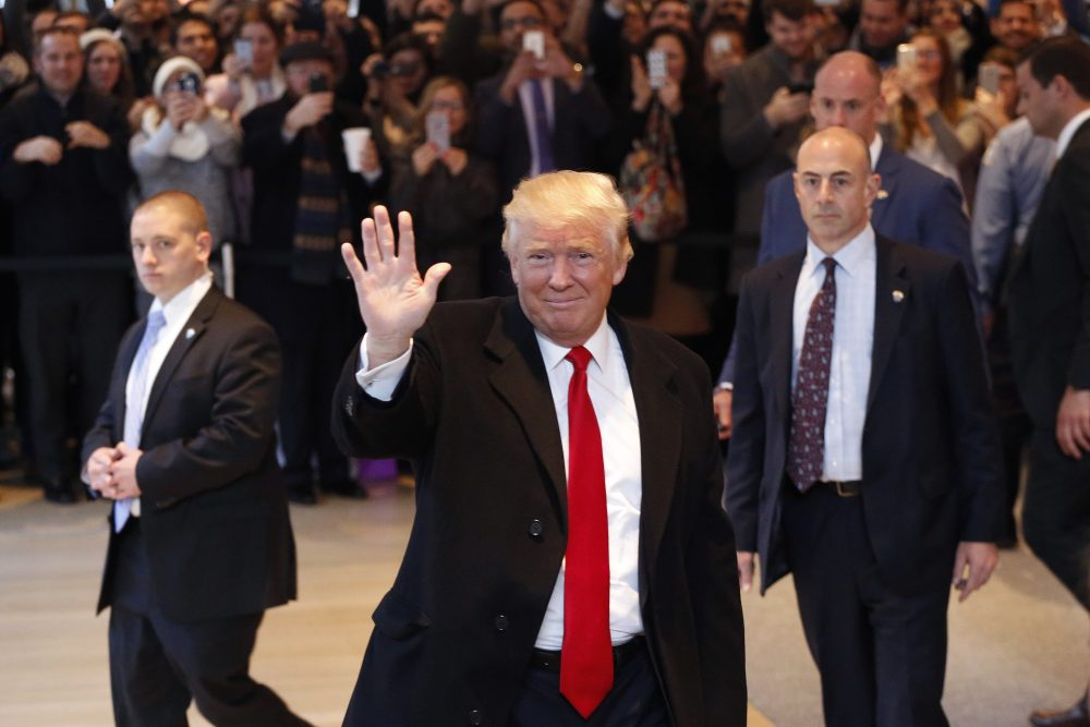President-elect Donald Trump waves to the crowd as he leaves the New York Times building following a meeting, Tuesday, Nov. 22, 2016, in New York. (Mark Lennihan/AP)