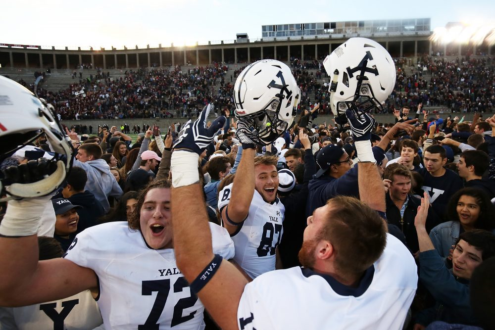 Last weekend the Yale football team celebrated its first victory over Harvard in a decade. (Adam Glanzman/Getty Images)