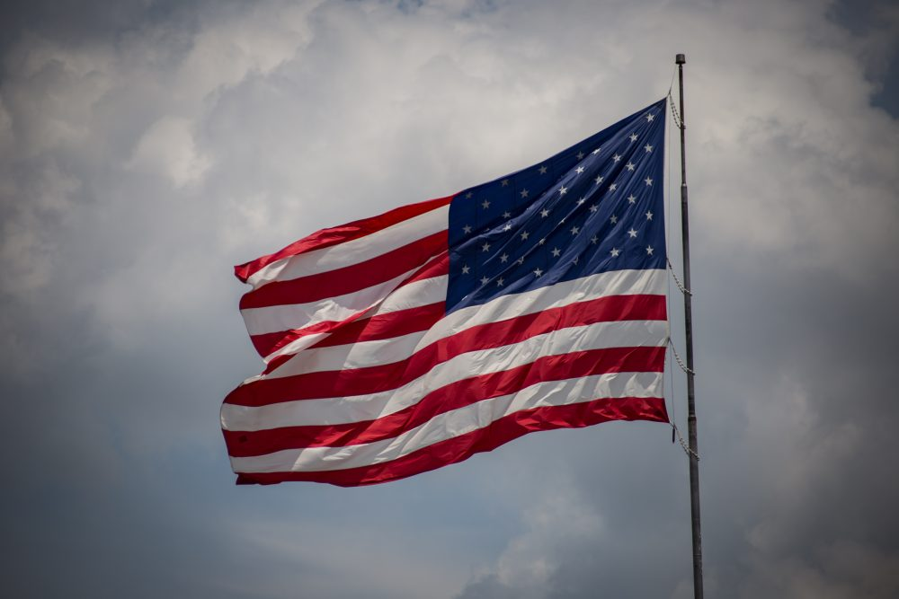 The removal of the American flag from Hampshire College's campus has generated strong reactions from community members, including veterans and students. (Jp VALERY/Unsplash)