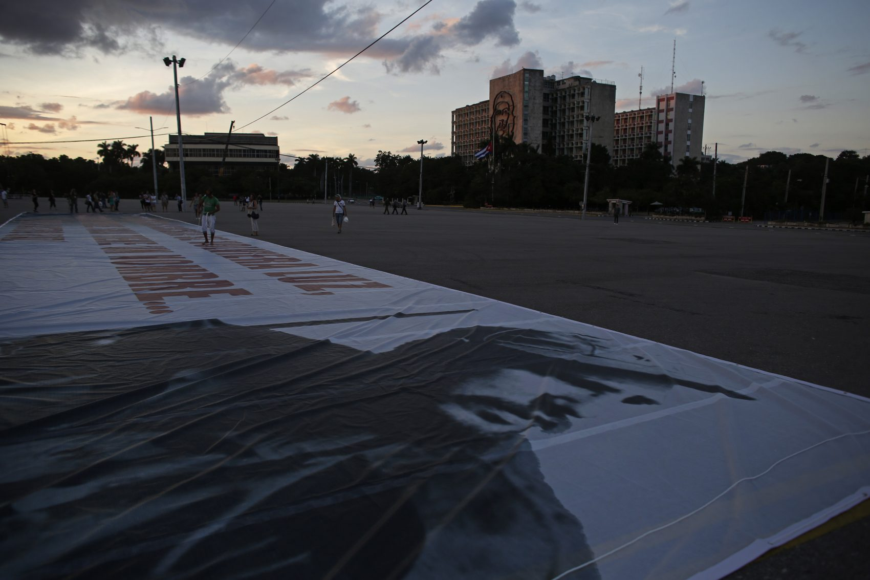 A giant banner with a photograph of the late Cuban leader Fidel Castro lies on the ground waiting to be hung at the Revolution Square in Havana, Cuba on Sunday. (Dario Lopez-Mills/AP)