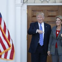 President-elect Donald Trump and Betsy DeVos, his pick for education secretary, pose for photographs at Trump National Golf Club Bedminster clubhouse in Bedminster, N.J., Saturday, Nov. 19, 2016. (Carolyn Kaster/AP)
