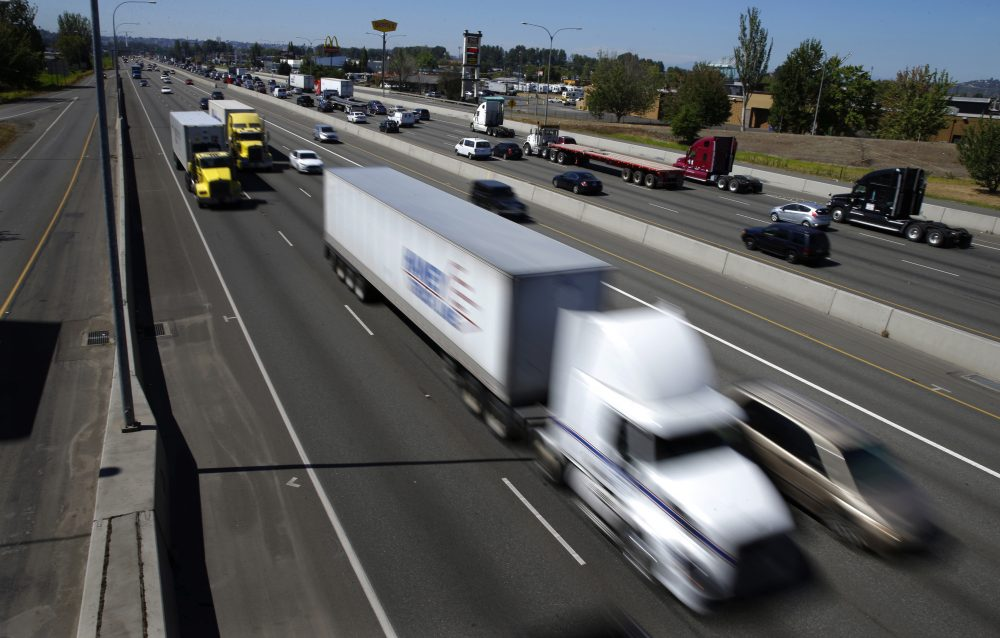 Truck and automobile traffic mix on Interstate 5, headed north through Fife, Wash., in August 2016. (Ted S. Warren/AP)