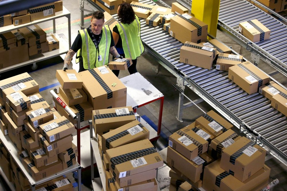 In this Monday, Dec. 2, 2013, file photo, Amazon.com employees organize outbound packages at an Amazon.com Fulfillment Center on Cyber Monday. (Ross D. Franklin/AP)