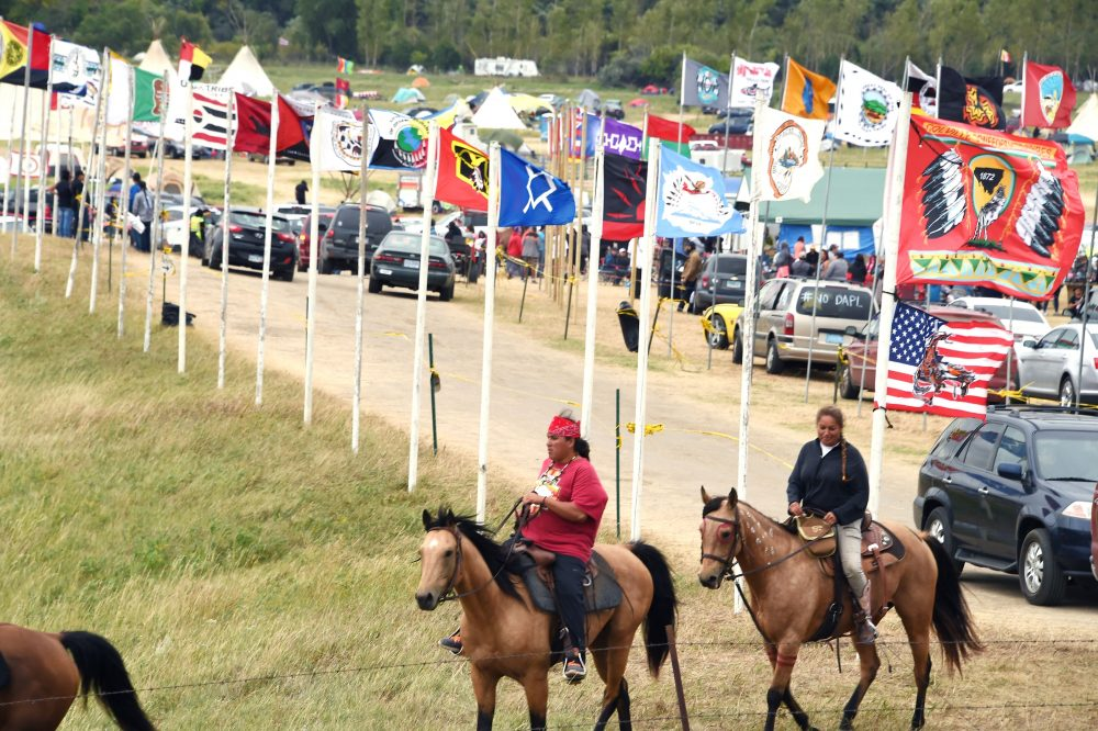 Flags of Native American tribes from across the U.S. and Canada line the entrance to a protest encampment near Cannon Ball, N.D. where members of the Standing Rock Sioux Tribe and their supporters gathered to voice their opposition to the Dakota Access Pipeline (DAPL), Sept. 3, 2016. (Robyn Beck/AFP/Getty Images)