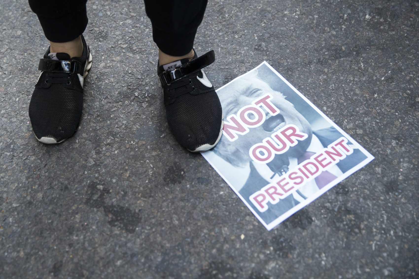 Do Americans of conscience have the energy and the will to shape themselves into a genuine and enduring protest movement? Pictured: Protestors stands on a poster during a demonstration against the election of President-elect Donald Trump during a rally outside Trump Tower, Saturday, Nov. 12, 2016, in New York. (Mary Altaffer/AP)