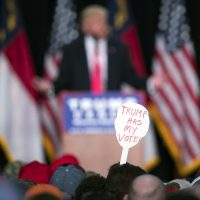 In this Monday, July 25, 2016 file photo, a supporter of Donald Trump holds a sign during a campaign rally in Winston-Salem, N.C. (Evan Vucci/AP)