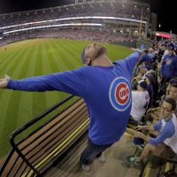 A Chicago Cubs  fan celebrates during the eighth inning of Game 7 of the Major League Baseball World Series against the Cleveland Indians Wednesday, Nov. 2, 2016, in Cleveland. (Charlie Riedel/AP)