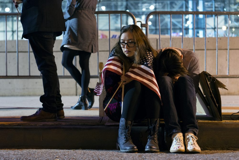 People stay outside the Jacob Javits Center waiting for election results following a rally for Democratic presidential candidate Hillary Clinton in New York Wednesday, Nov. 9, 2016. (Craig Ruttle/AP)
