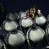 Emily Benn stays in a seat at the end of Democratic presidential nominee Hillary Clinton's election night rally at the Jacob Javits Center in New York, Wednesday, Nov. 9, 2016. (David Goldman/AP)