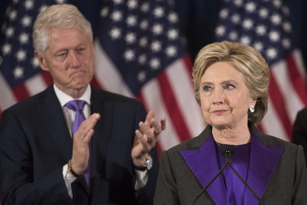 Hillary Clinton gives her concession speech on Wednesday, Nov. 9, as her husband, former President Bill Clinton, applauds behind her. (Matt Rourke/AP)