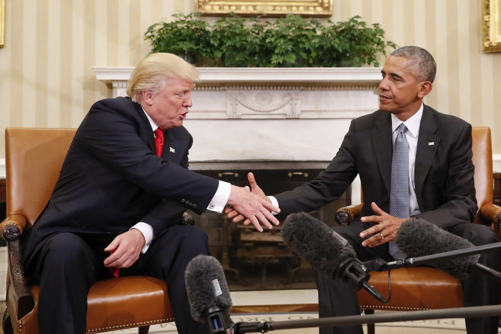 President Obama and President-elect Trump shake hands following their meeting in the Oval Office Thursday. (Pablo Martinez Monsivais/AP)