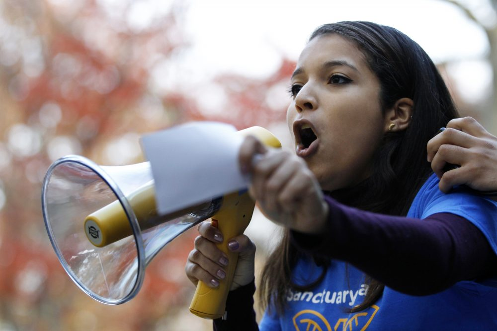 Rutgers University junior Carimer Andujar shouts to a large crowd gathered to protest some of President elect Donald Trump policies and to ask school officials to denounce his plans at Rutgers University Wednesday, Nov. 15, 2016, in New Brunswick, N.J. (Mel Evans/AP)