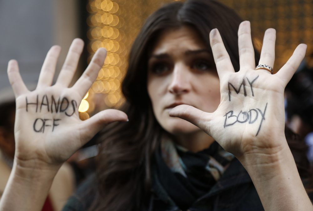Sarah Hunt from Queens, New York, displays a message on her hands across the street from Trump Tower in New York, Thursday, Nov. 17, 2016. (Seth Wenig/AP)