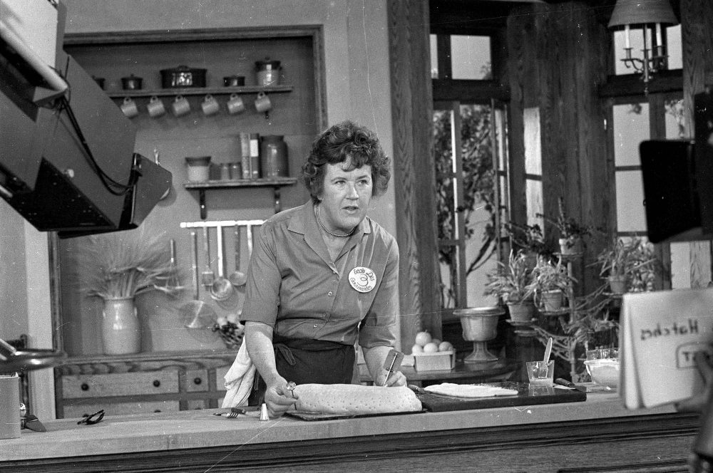 This Nov. 24, 1970 photo shows television cooking personality Julia Child preparing a French delicacy in her cooking studio. (AP Photo/FILE)