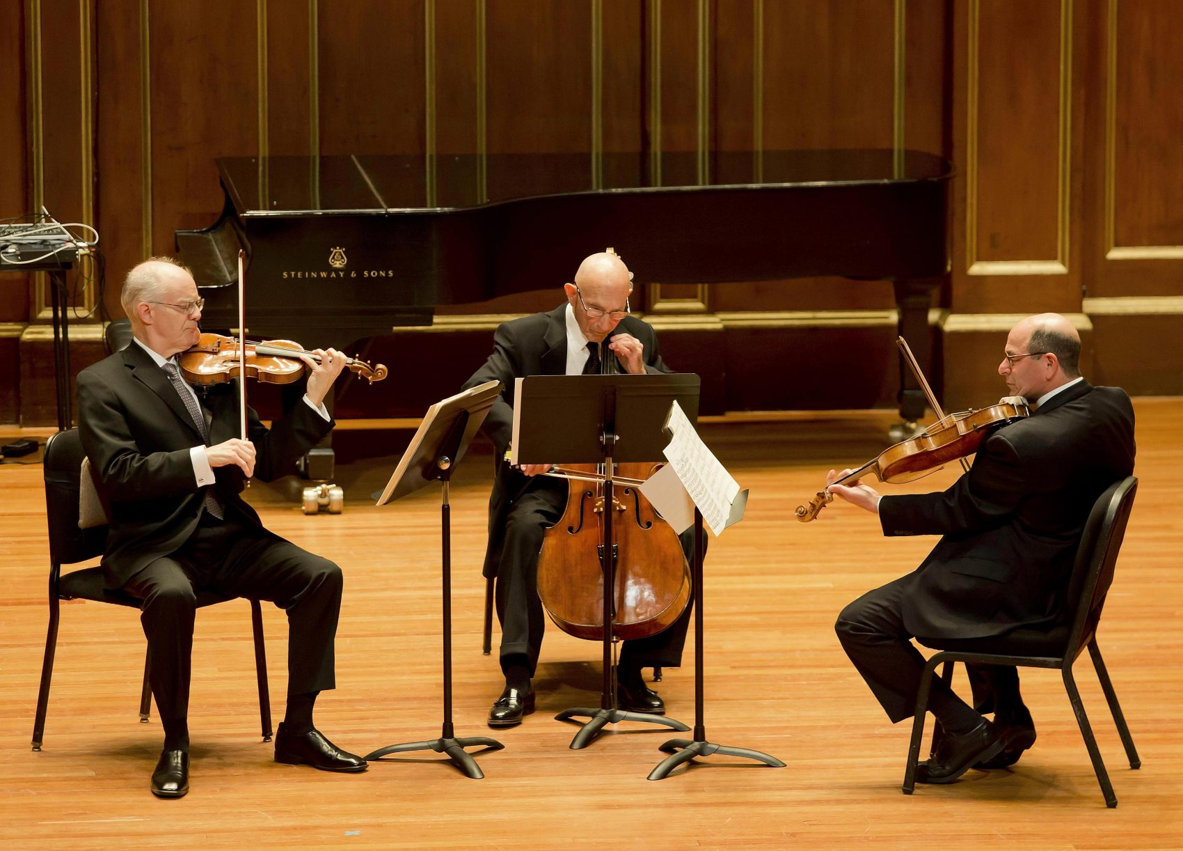 Jules Eskin performing in  a Boston Symphony Orchestra concert with Malcolm Lowe (left) and  Steven Ansell in 2015.  (Courtesy Winslow Townson/Boston Symphony Orchestra)