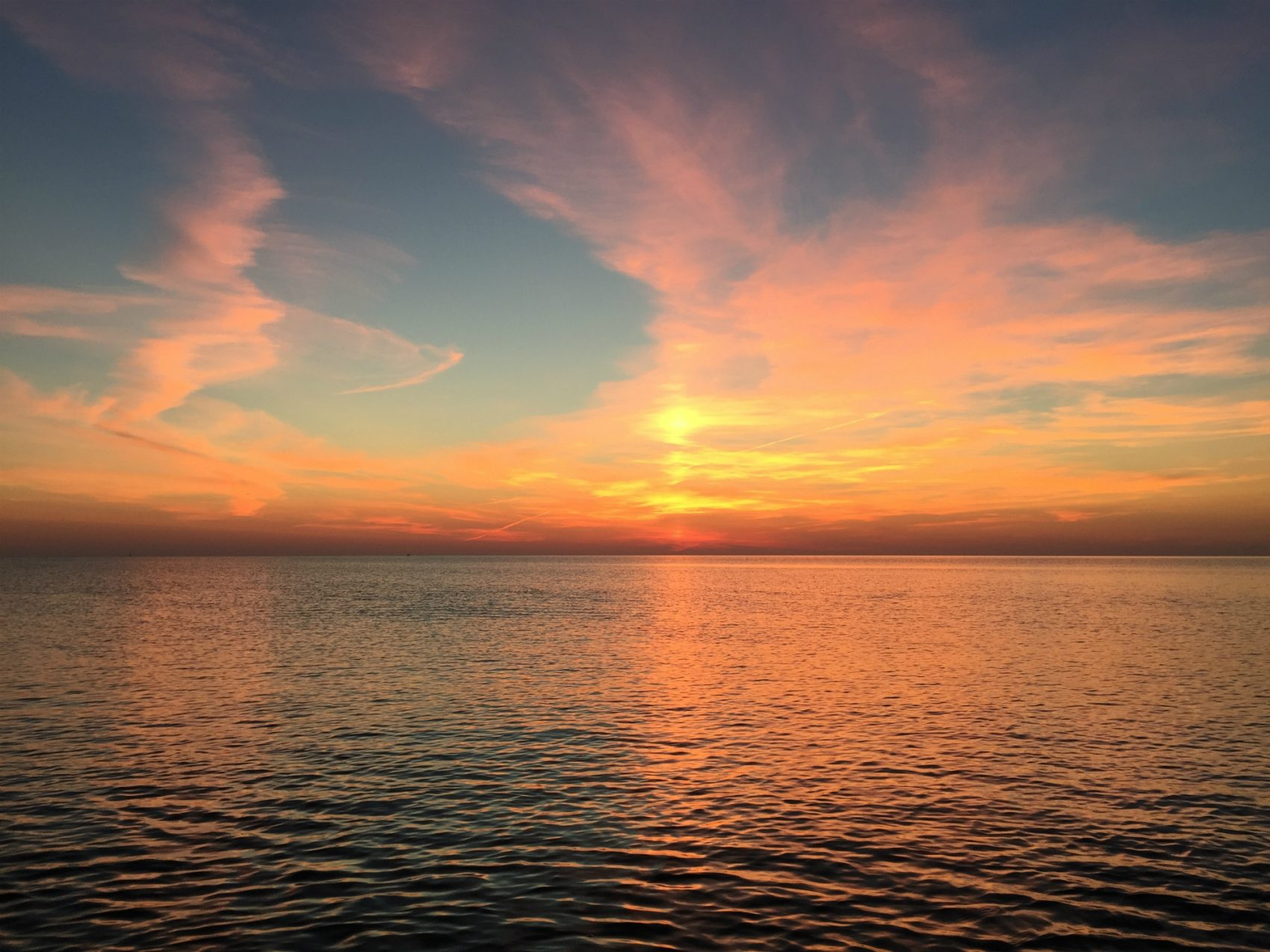 For those who aren't usually outside or even awake for a sunrise, writes Collin Sheehan, now is your chance to enjoy sunset's less popular sibling. Picutred: Sunrise from Plum Island taken in mid-September, back when you had to get up early for it.(Author/Courtesy)