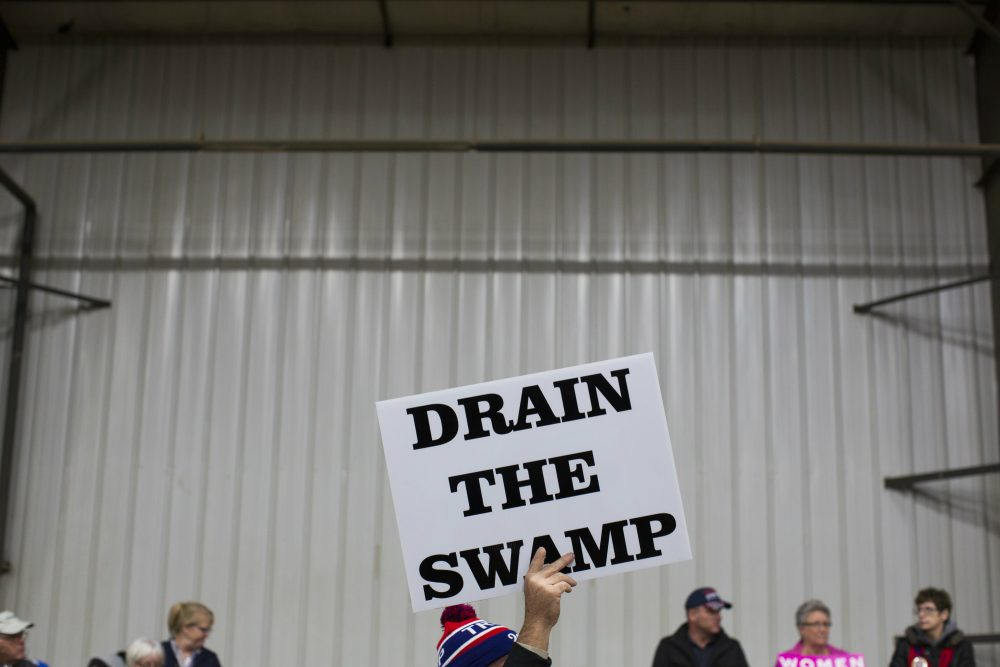 Jarrod is not afraid that Trump will install a kleptocratic oligarchy. writes Sebastian Stockman. He just assumes the president-elect will join the one that already exists. Pictured: Supporters of then-Republican presidential candidate Donald Trump hold signs during a campaign rally. (Evan Vucci/ AP)