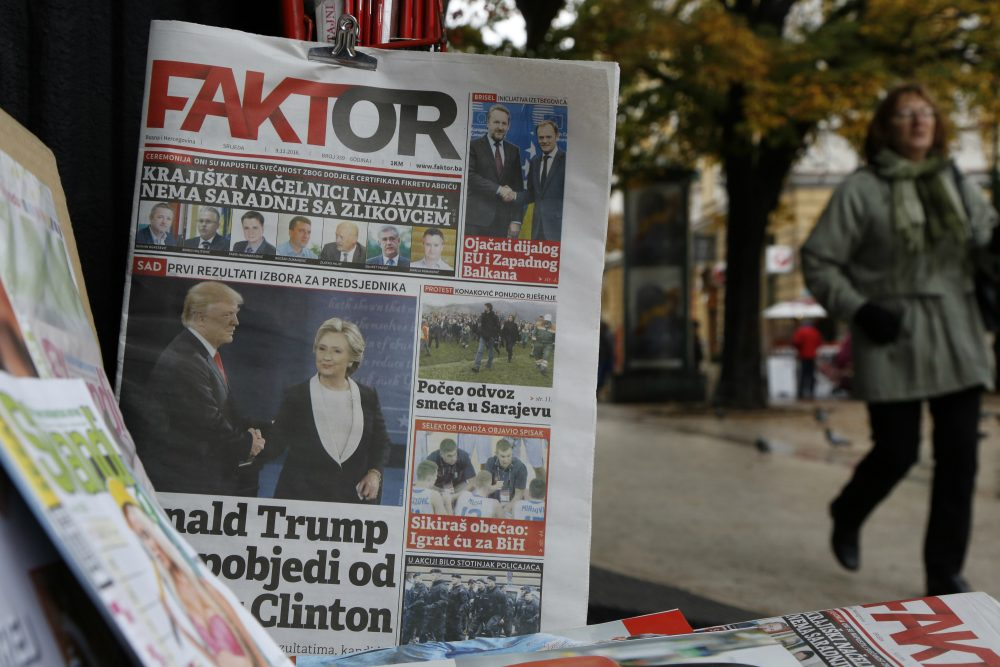 This was the America that welcomed me as a teenager, never cared where I was from, and never made me feel like I was an outsider, writes Ismar Volić. Pictured: Bosnian people passes by daily newspapers with photos of President-elect Donald Trump published in newspaper, in Sarajevo, Bosnia, on Wednesday, Nov. 9, 2016. (Amel Emric/AP)