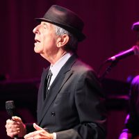 In this file photo, Leonard Cohen performs on the Old Ideas World Tour, at Atlanta's Fox Theatre. The legendary singer and songwriter has died at the age of 82. (Robb D. Cohen/AP)