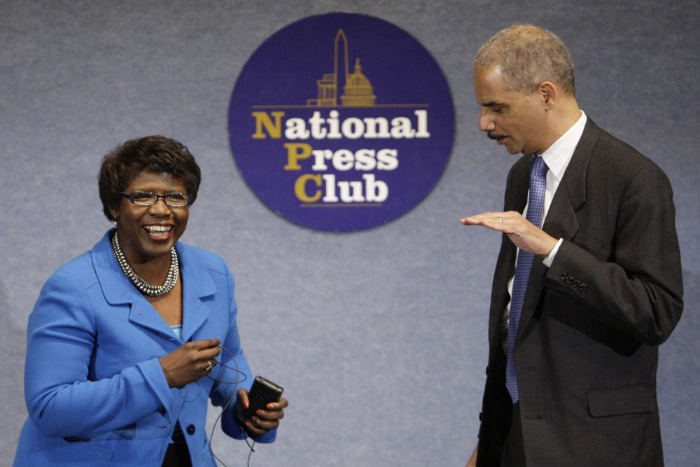 In this file photo, Attorney General Eric Holder talks with Gwen Ifill during a NAACP Legal Defense and Educational Fund luncheon. Ifill died Monday, November 14 2016 at the age of 61. (Alex Brandon/AP)